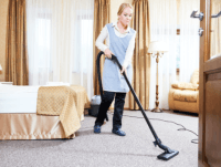 female using vacuum