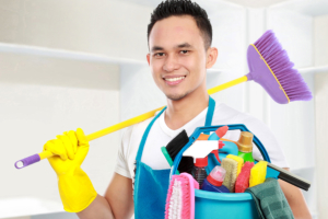 man holding cleaning tools
